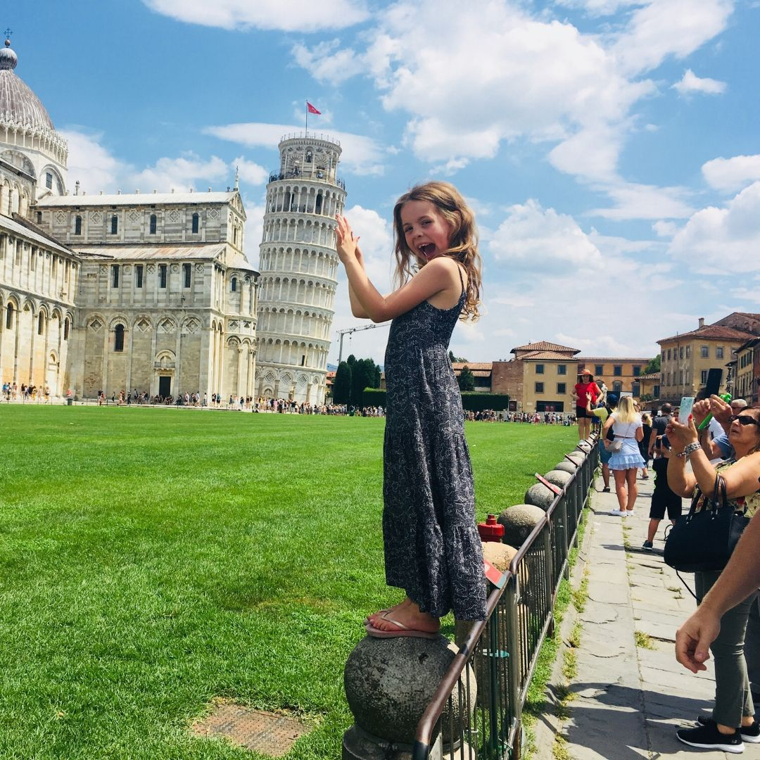 lots of people taking pictures of the leaning tower of pisa