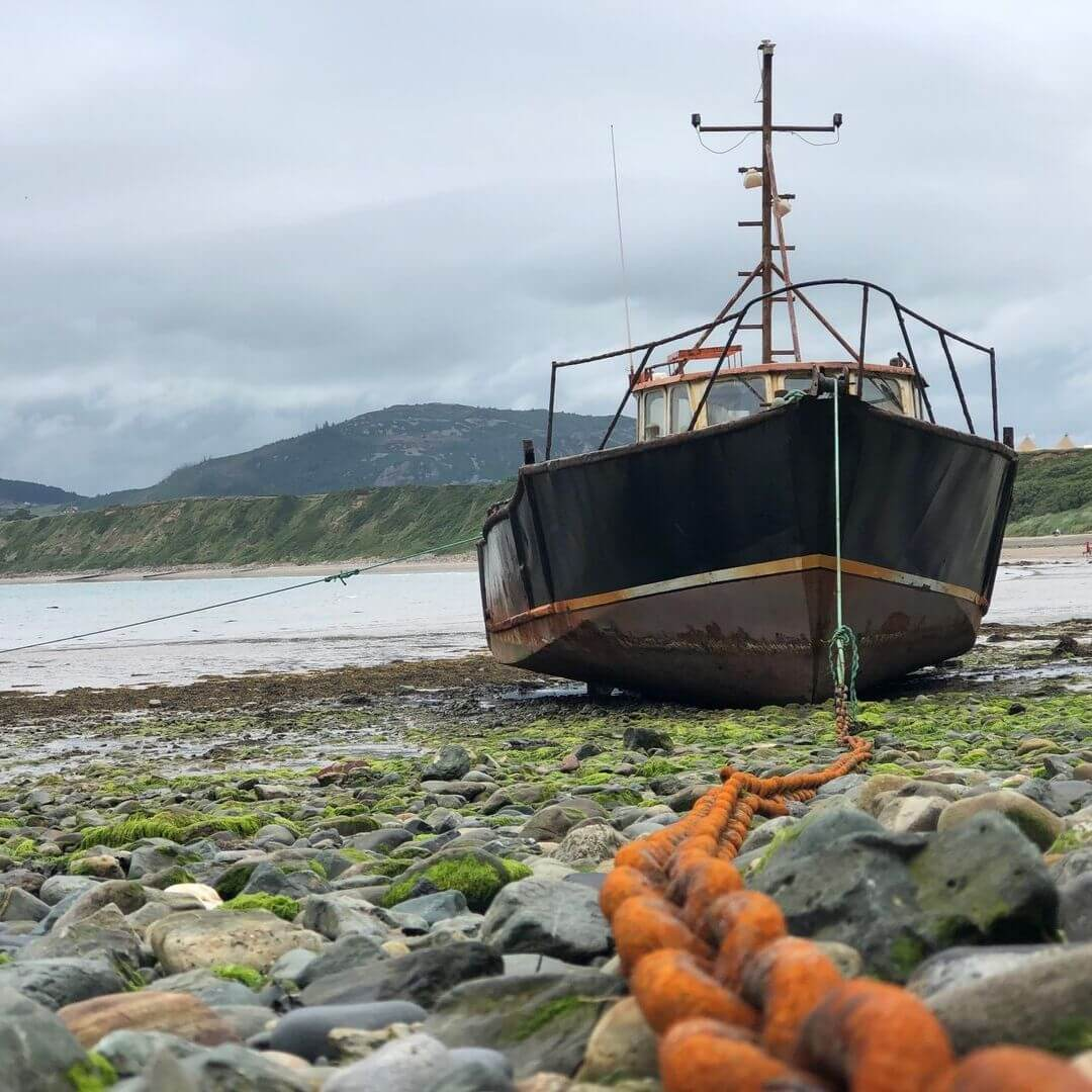 Old Boat Moored Up At Nefyn Beach, North Wales