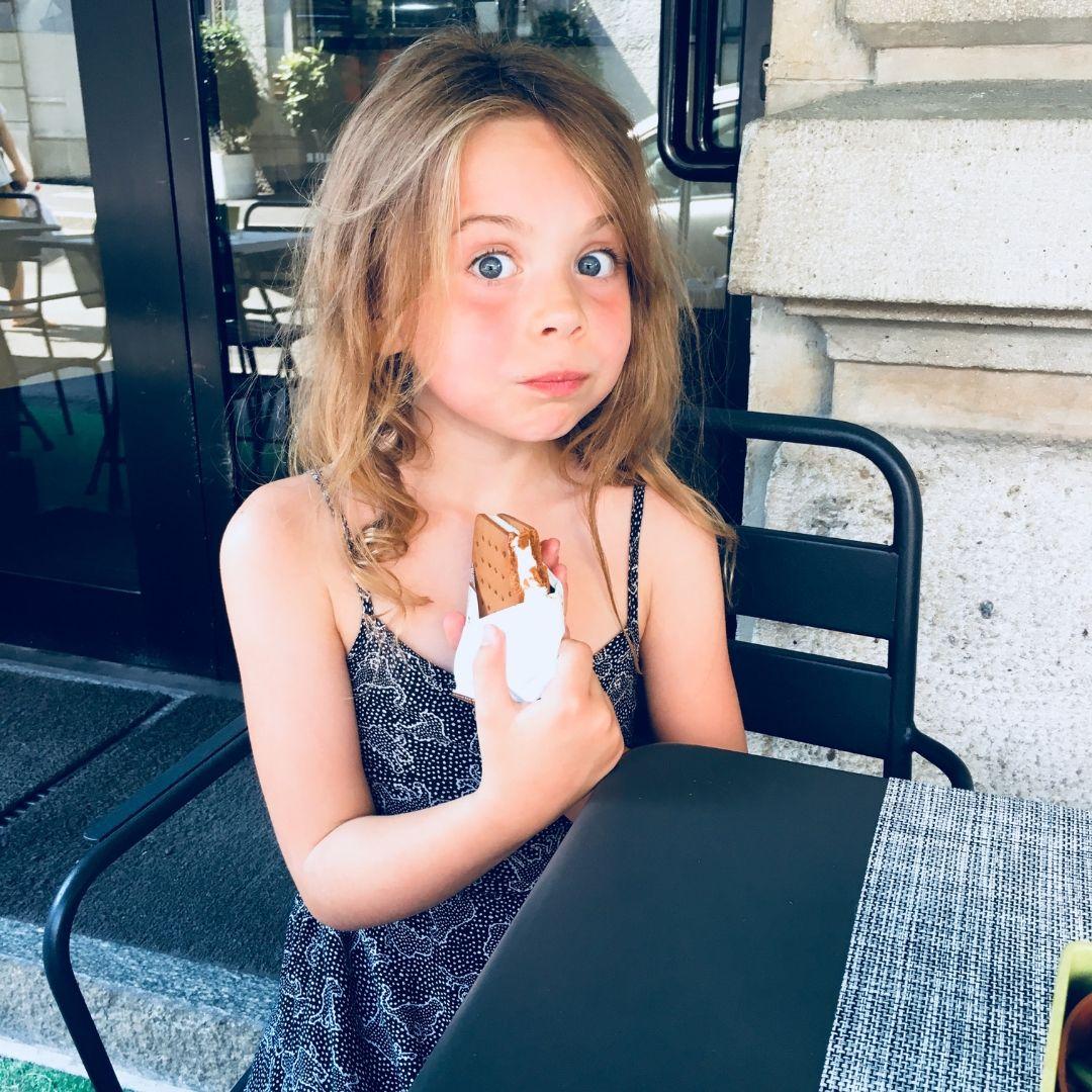 piper quinn eating an ice cream sandwich in Milan