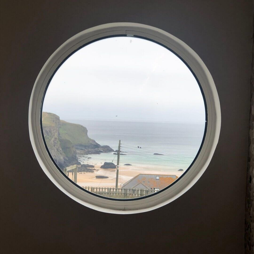 porthole view of coastline in north cornwall