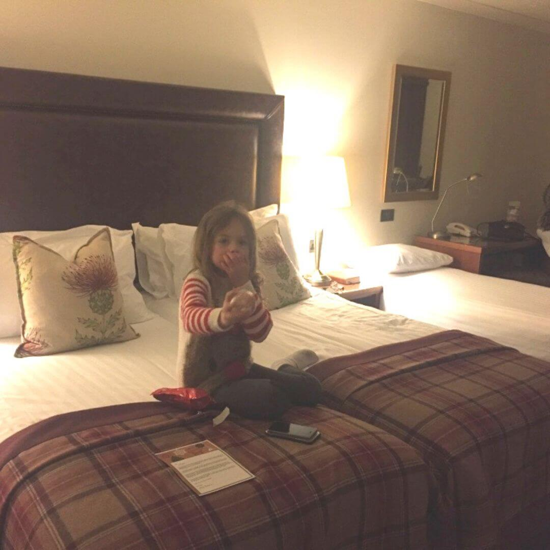 bedroom at the mac donald aviemore hotel