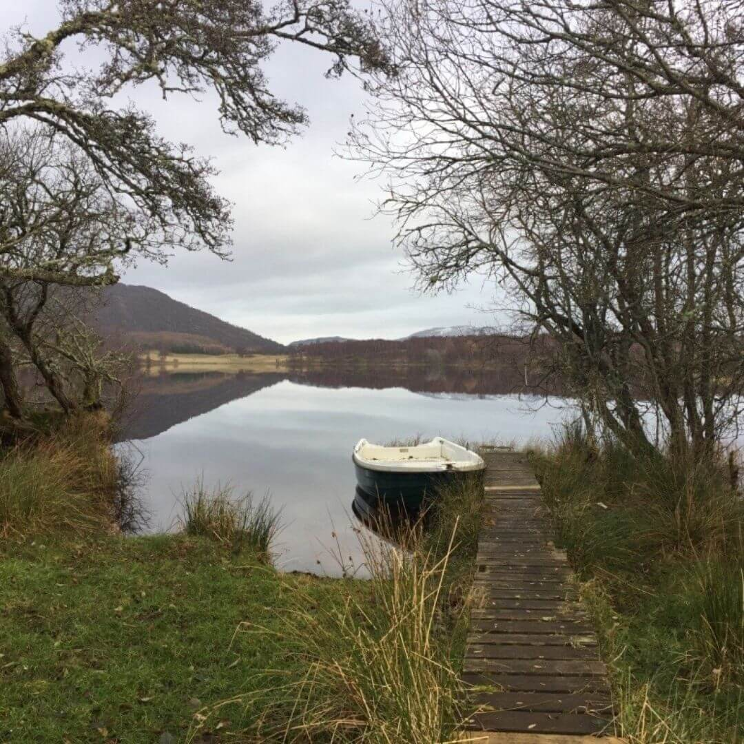 Beautiful Loch With Boat In Aviemore Scotland