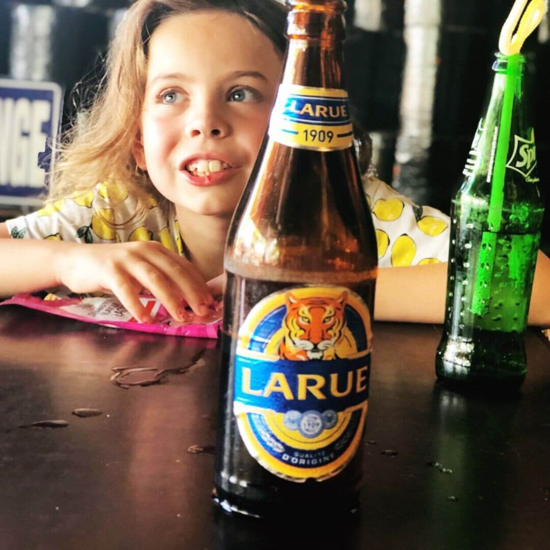 Bottle Of Cold Larue Beer With 9 Year Old Girl In The Background
