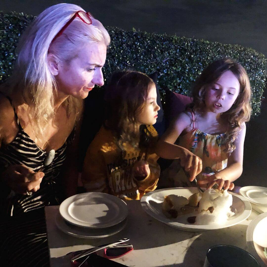 mother and two daughters sharing a desert at Zoom bar