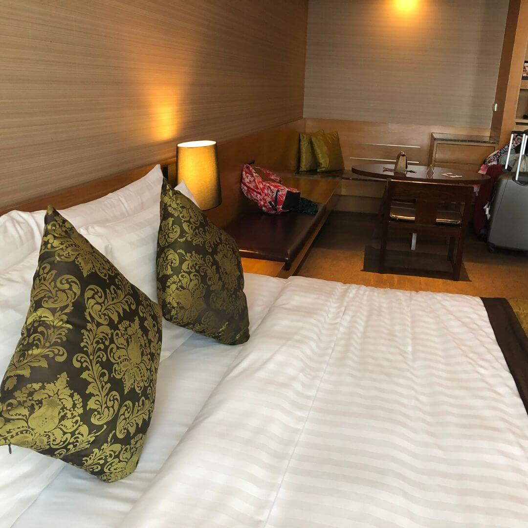 big bed at the anantara sathorn hotel in a premier room