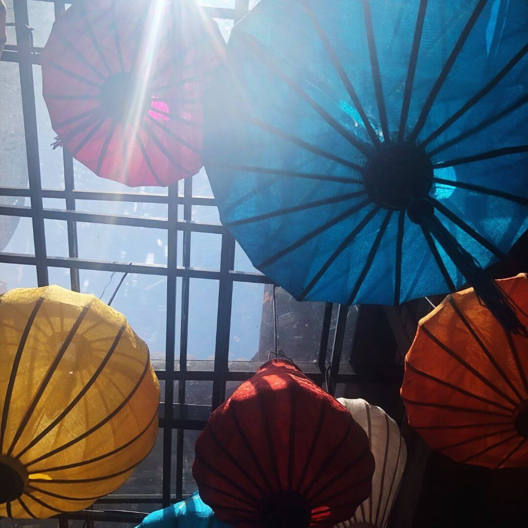 colourful lanterns hanging on the ceiling from below