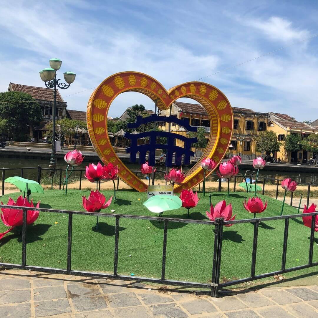 decorative heart sculpt surrounded by paper flowers