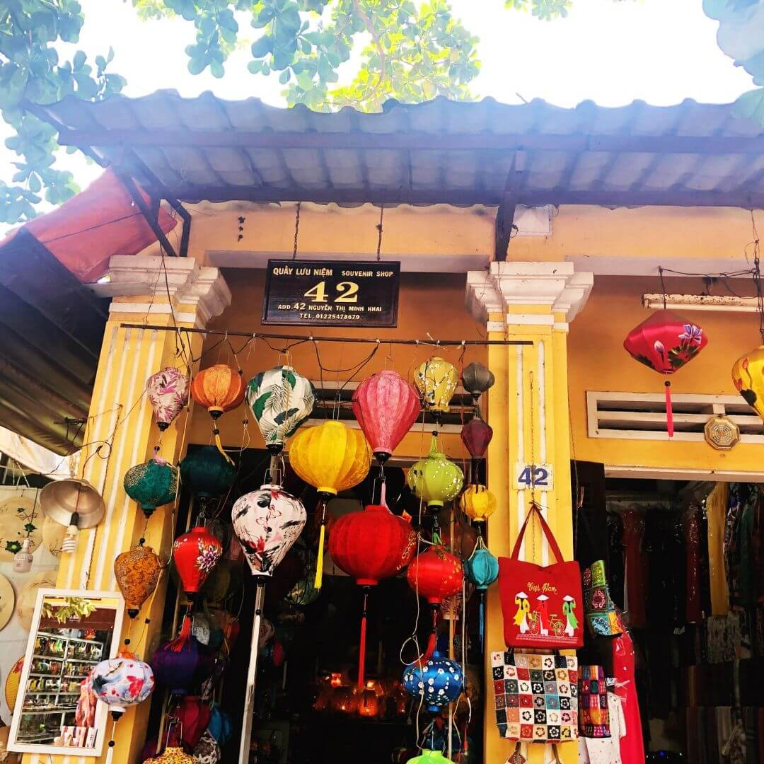 pretty shop front covered in colourful lanterns