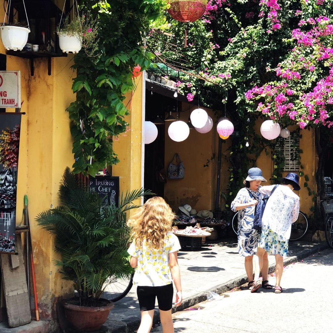 young girl wandering the pretty streets of hoi an