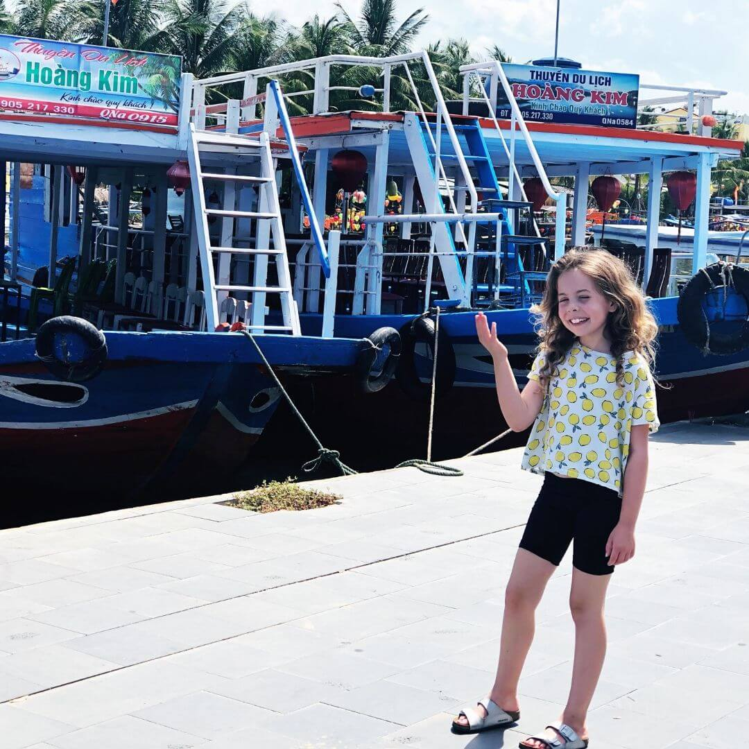 girl staring outside of a tour boat in hoi an