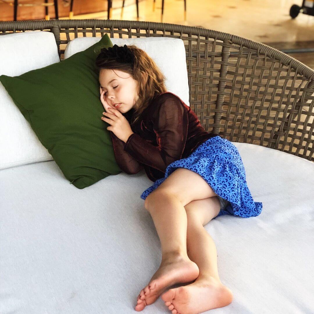 child asleep on a hotel chair in vietnam