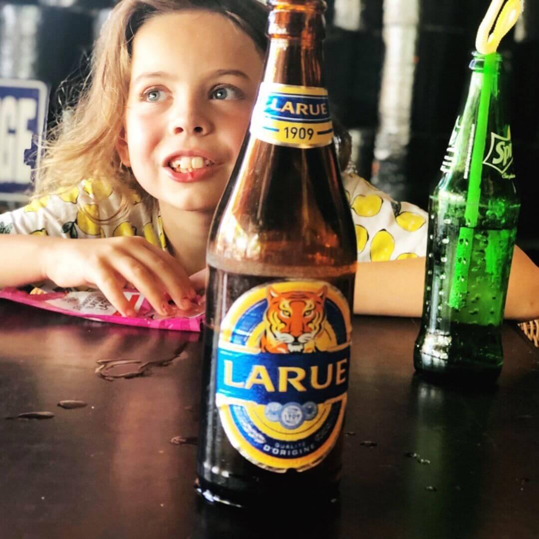 piper quinn behing a bottle of bintang