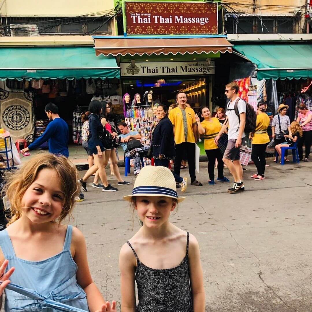 two smiling girls on the khao san road in bangkok