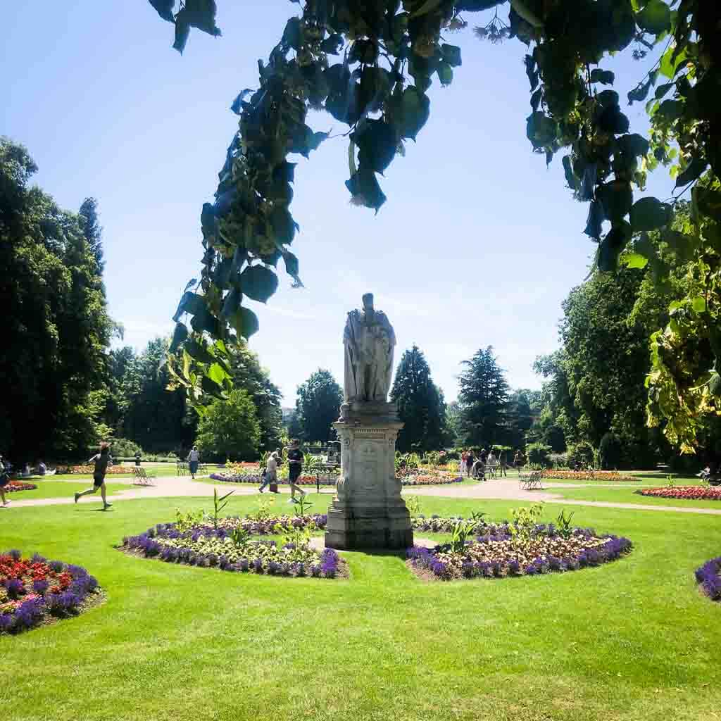 Colourful Flowers Surrounding A Statue In Beacon Park
