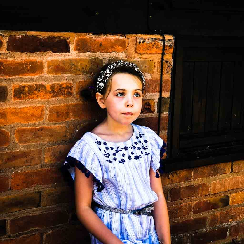 Girl In Blue And White Dress And Leopard Print Headband