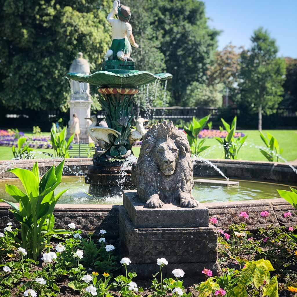 Lion Fountain In Beacon Park Surrounded By Colourful Flowers