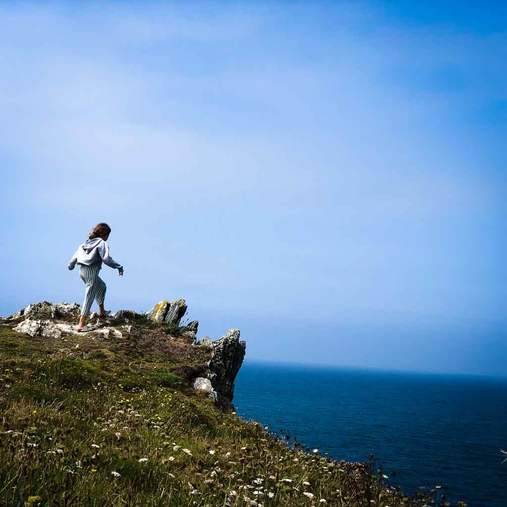 young girl exploring the cornish coast path