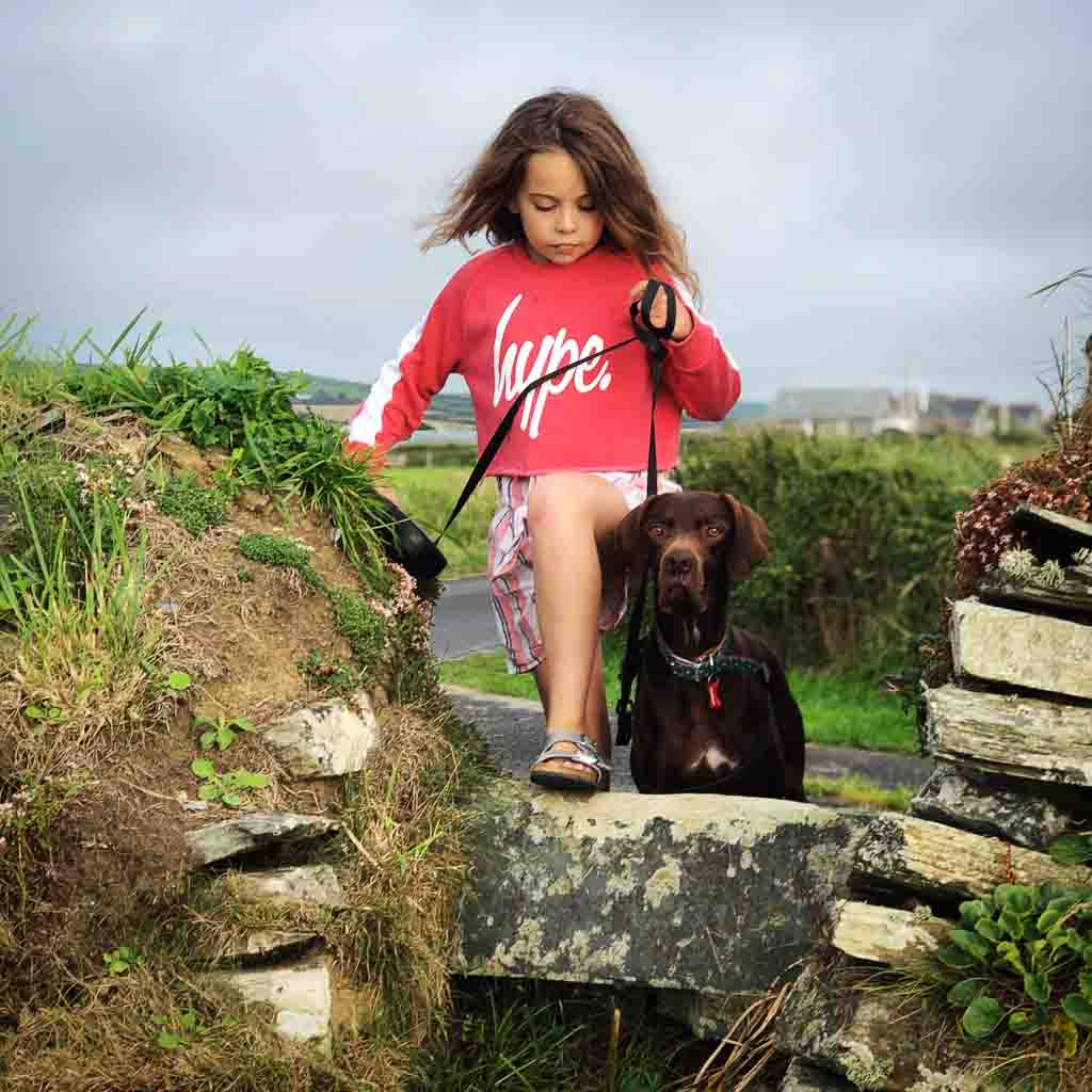 9 year old girl and dog walking the cornish coast path