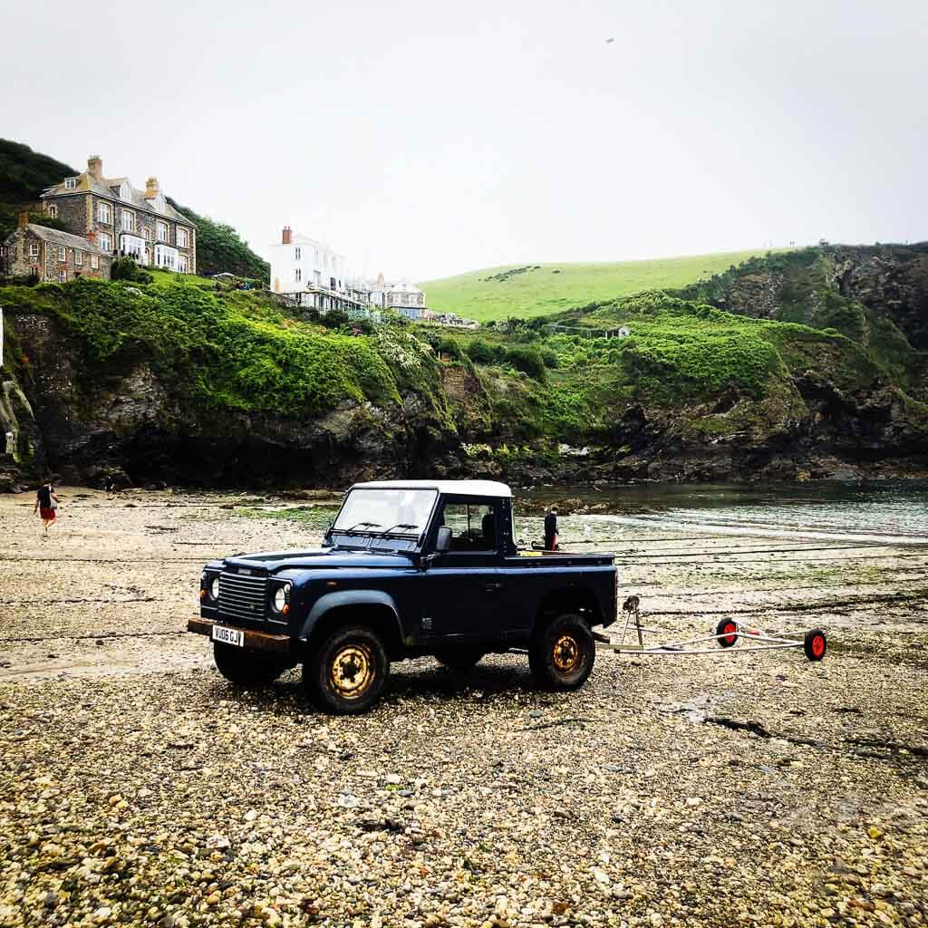 Blue Landcover Parked On Beach At Port Isaac