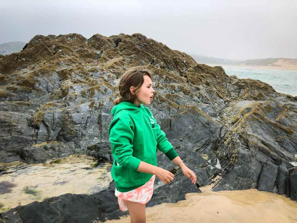young girl in green hoody at vugga cove