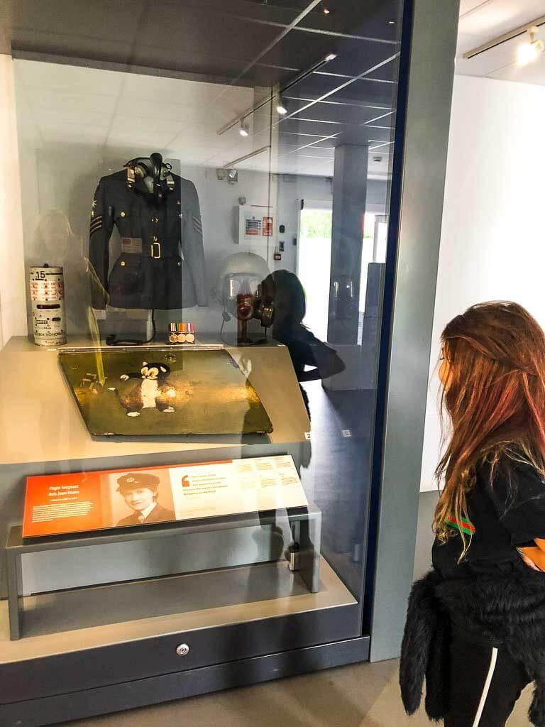 Girl Looking At Exhibit In Museum