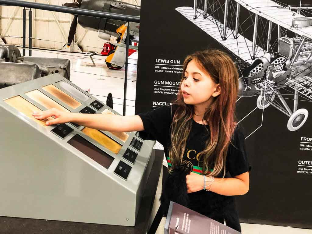 Piper Quinn Touching Different Materials Used To Build Aircraft