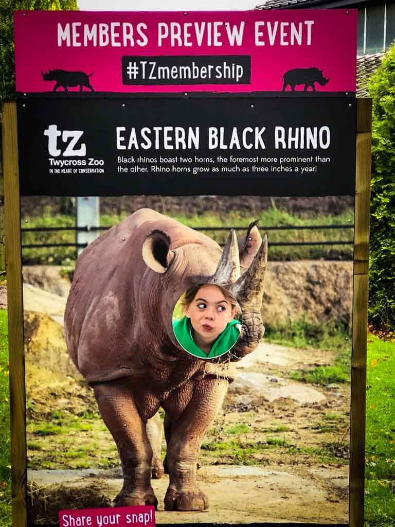Girl Pulling Funny Face In Rhino Sign