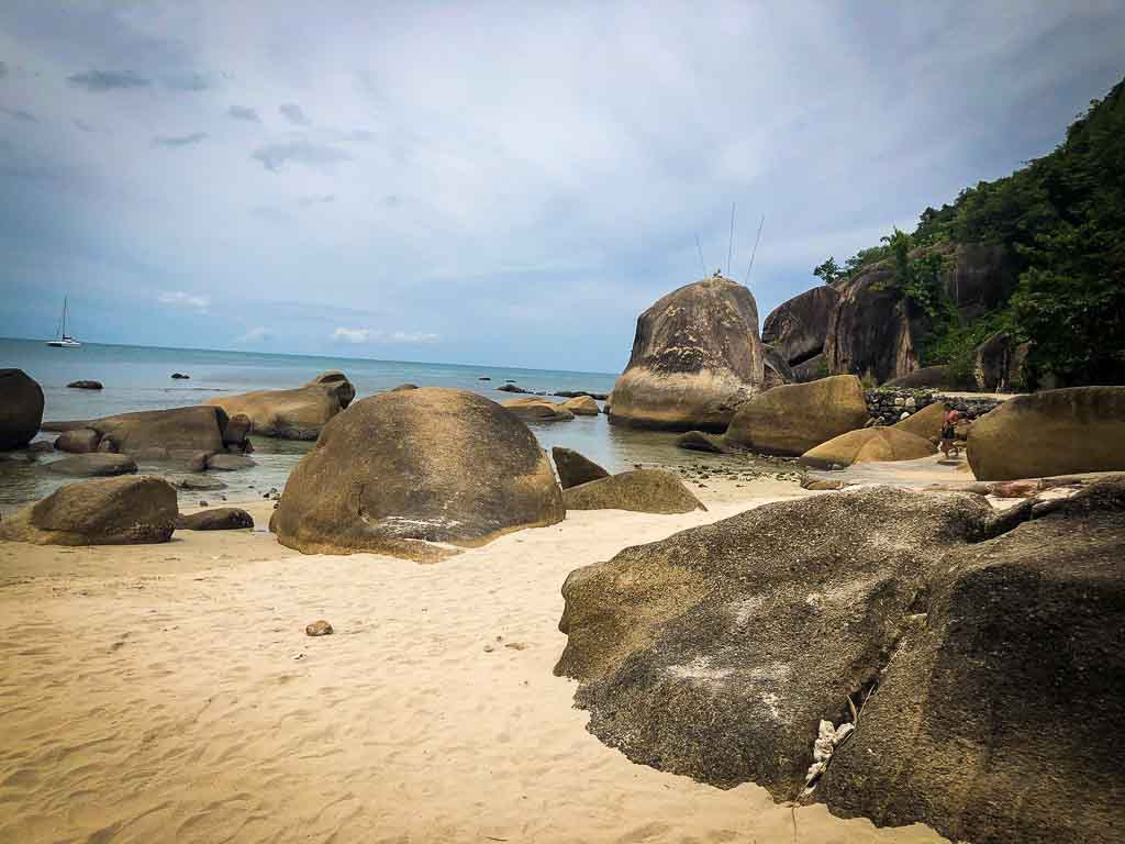 rounded boulders on a beach in asia