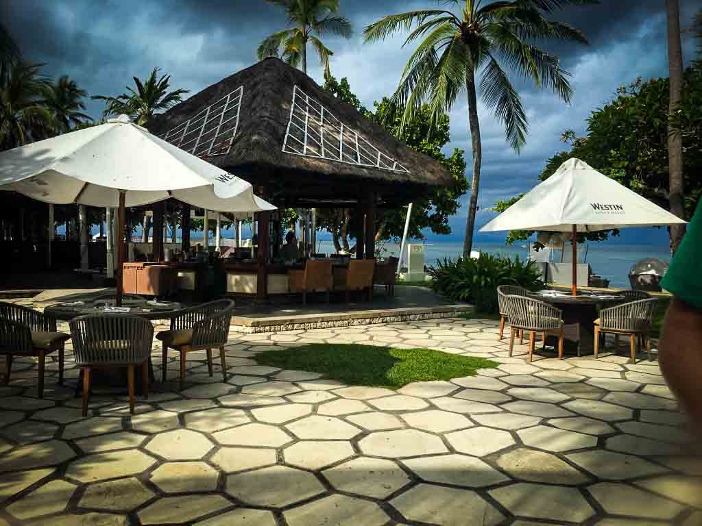 outdoor seating at the ikan restaurant in nusa dua