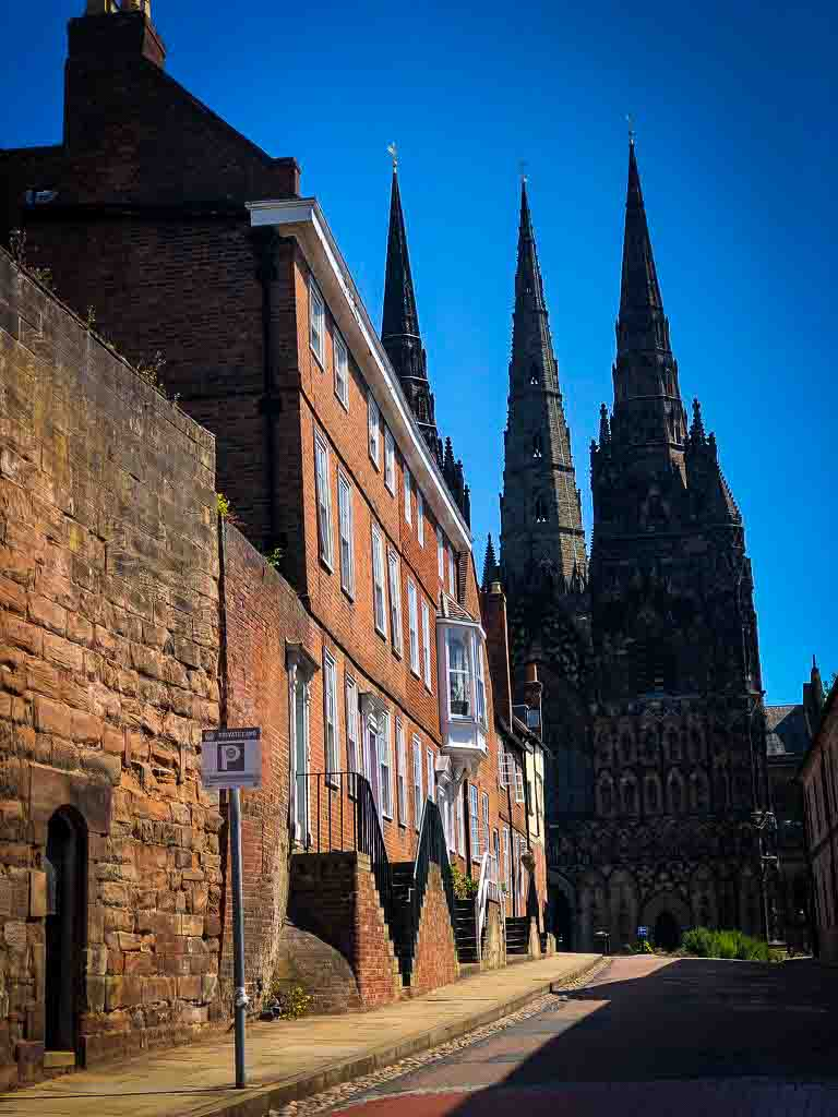 lichfield cathedral shot from the bottom of a street