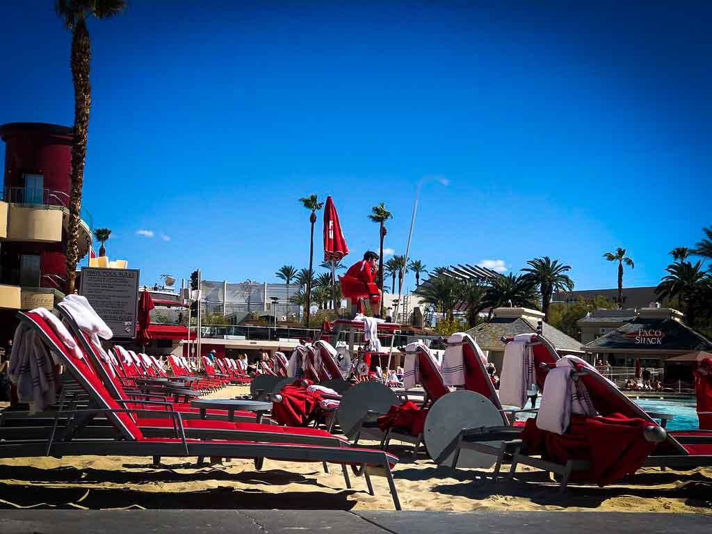 red sun loungers under a blue sky at the Mandalay bay hotel