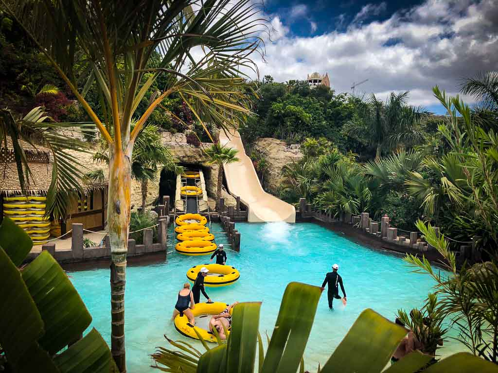 people getting off a water slide at siam park