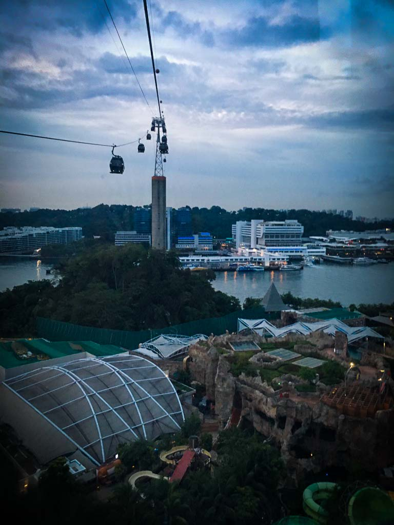 view of singapore cable car going across the water