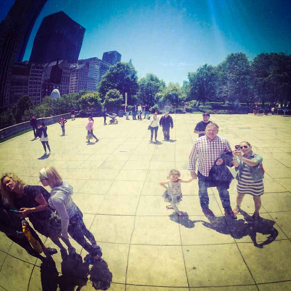 reflection of a family in the chicago bean