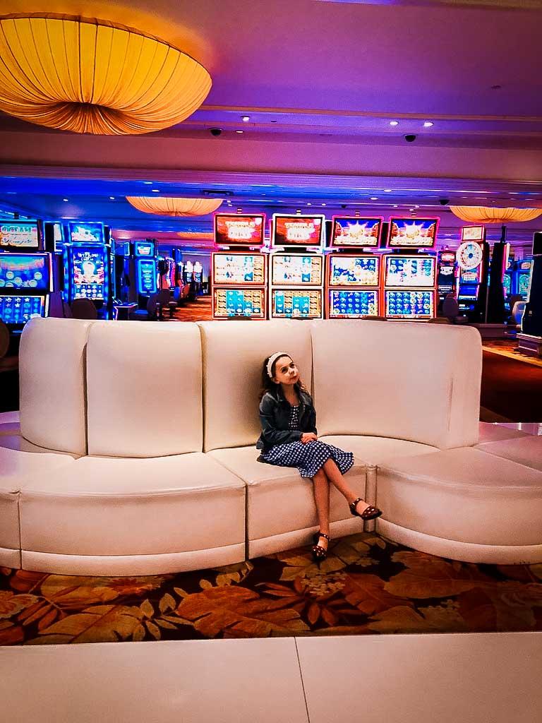 piper quinn sat on a white sofa infront of a casino in las vegas