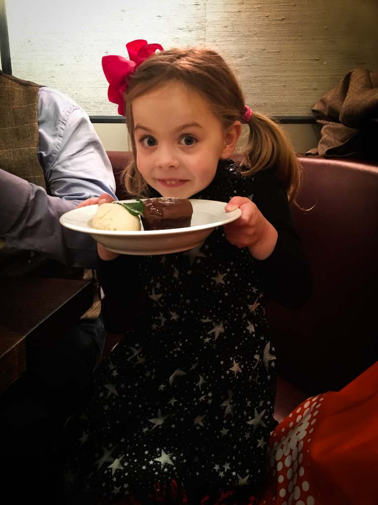piper quinn with a bowl of chocolate cake in a restaurant in london