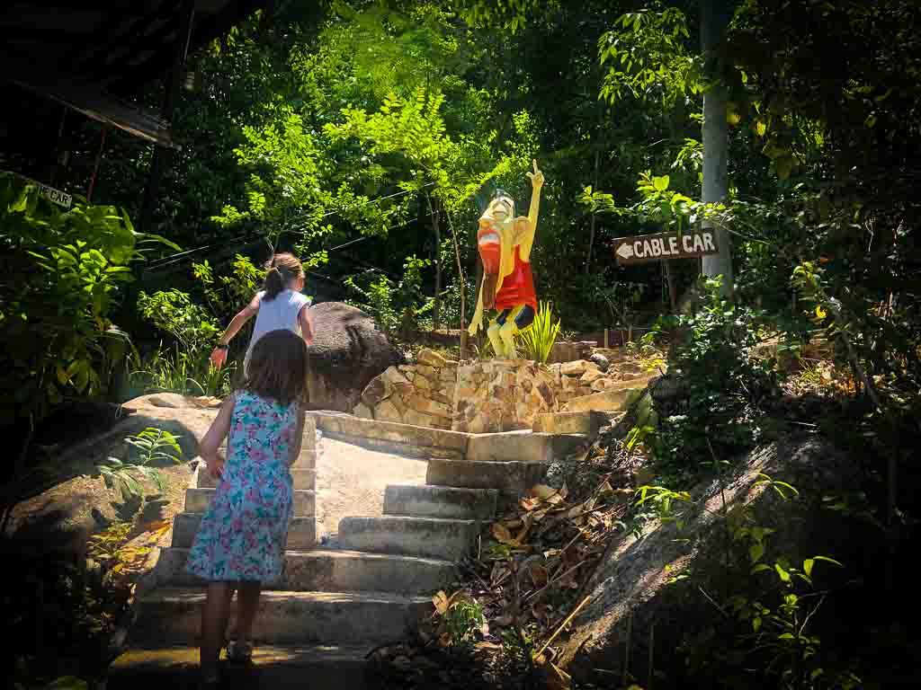 girls climbing stone steps at lamai viewpoint