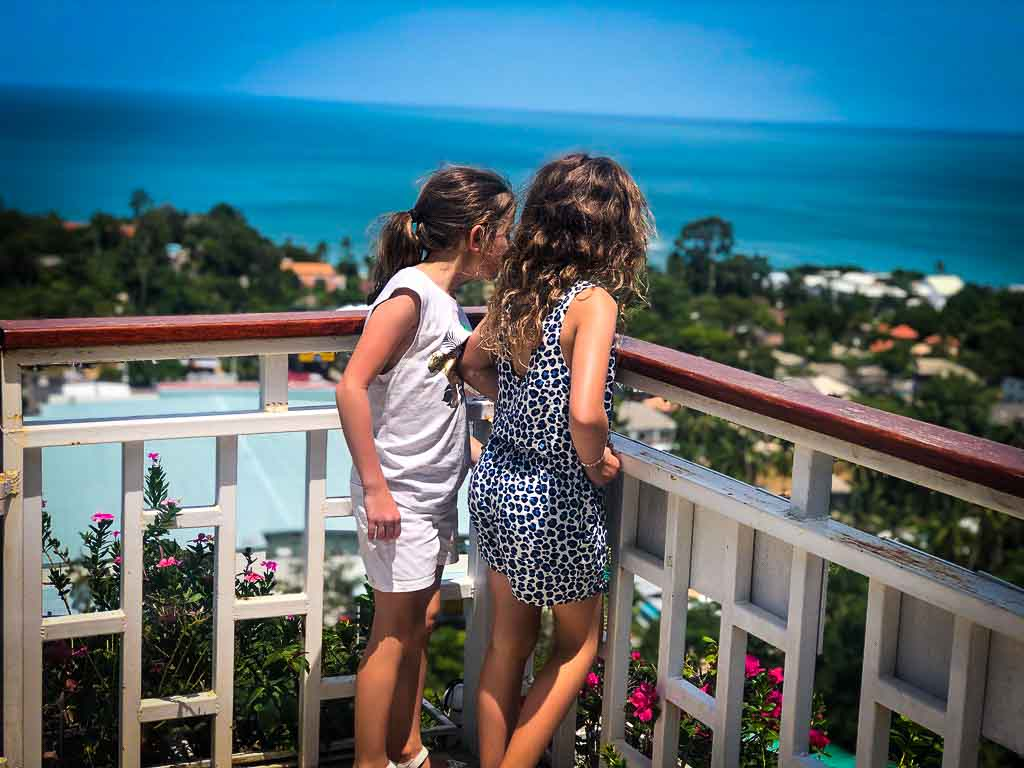 two young girls looking out at the sea from the lamai viewpoint