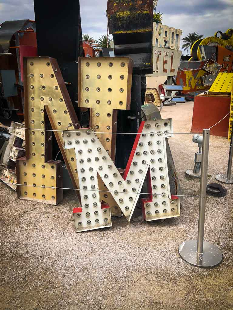 m letter neoon sign infront of N letter neon sign