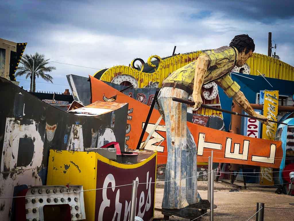 mullet man neaon sign sculpture playing pool