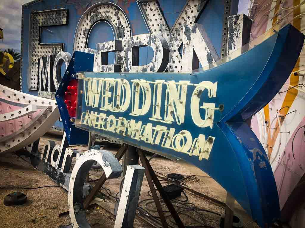 blue and white wedding information neon sign at the las vegas boneyard
