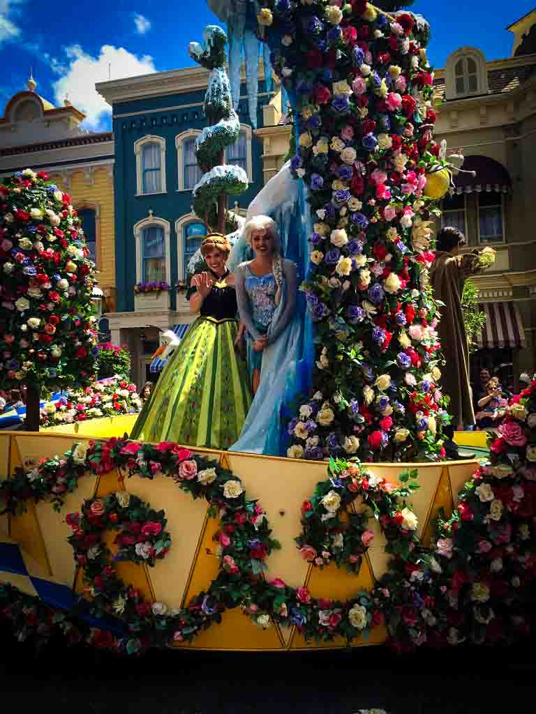 anna and elsa characters of float at disney world