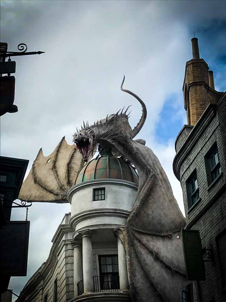 huge dragon on building at the wizarding world of harry potter