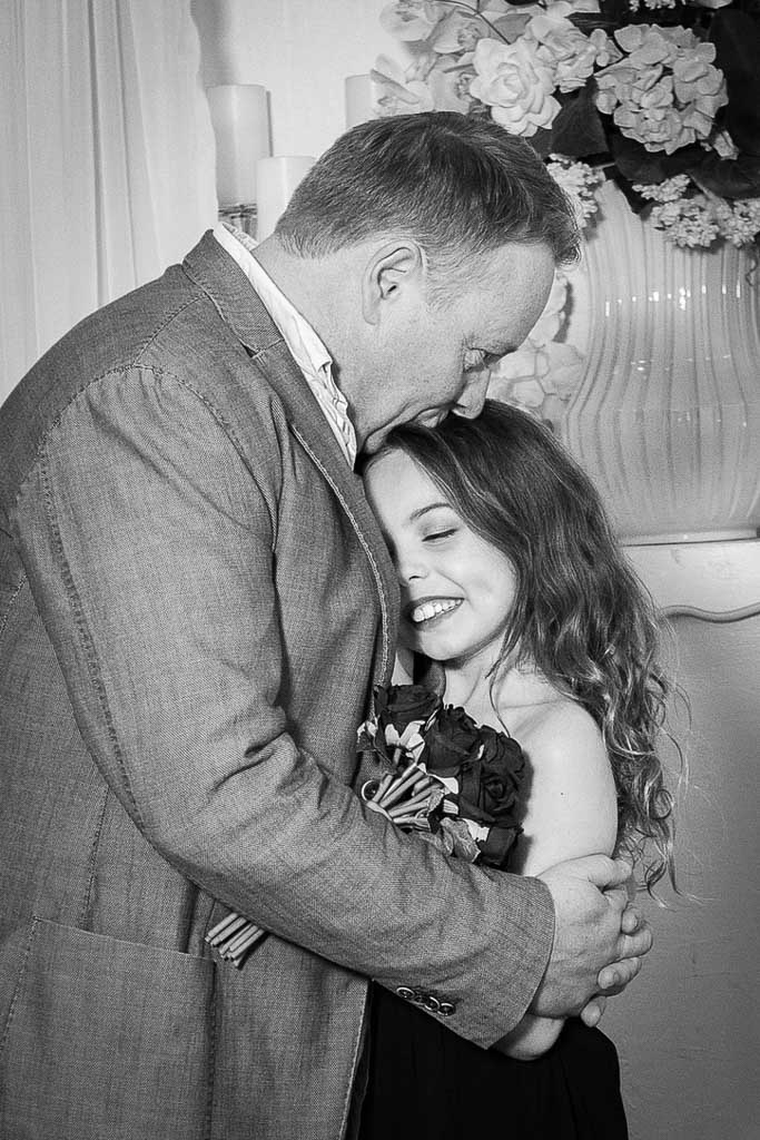 nigel quinn hugging his 10 year old daughter at this wedding renewal
