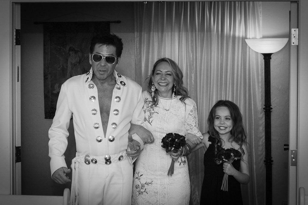 elvis impersonator walking karen quinn and her daughter down the aisle