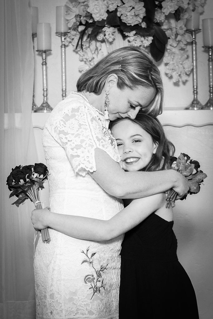 karen quinn in a wedding dress hugging her daughter piper quinn