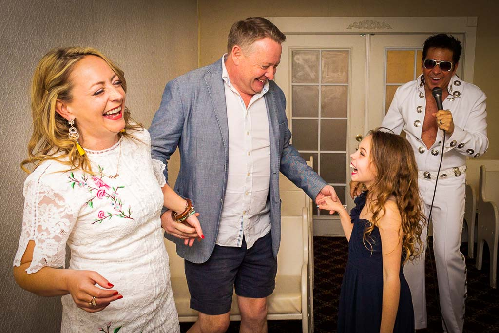 family of 3 dancing to an evlis impersonator during their vow renewal