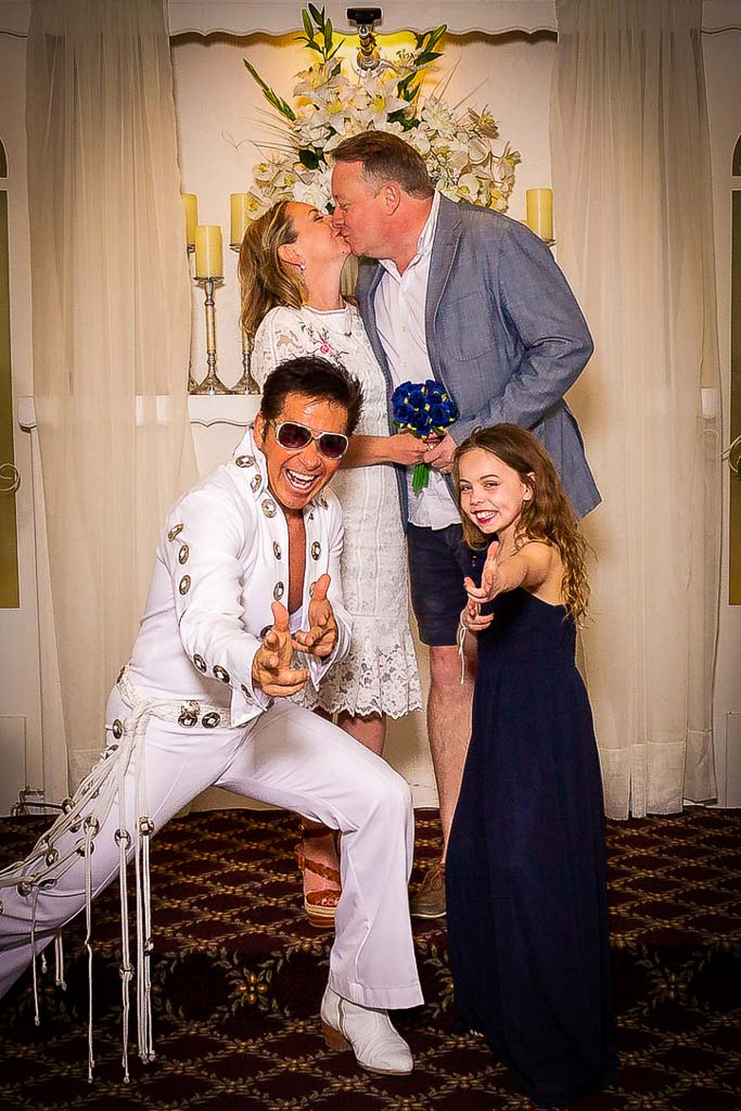 the quinn family posing at their wedding renewal with elvis and 10 year old daughter